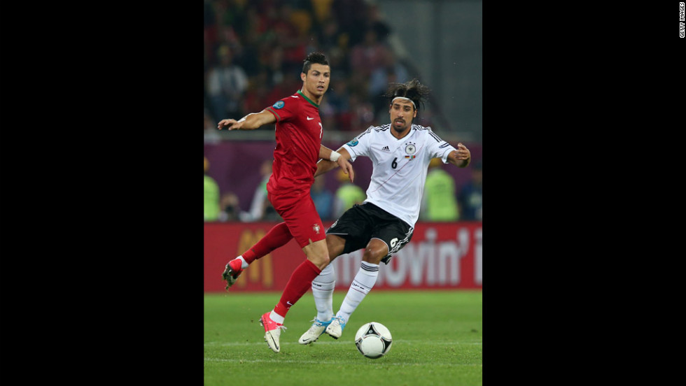Cristiano Ronaldo of Portugal and Sami Khedira of Germany fight for the ball in a match on Saturday, June 9.