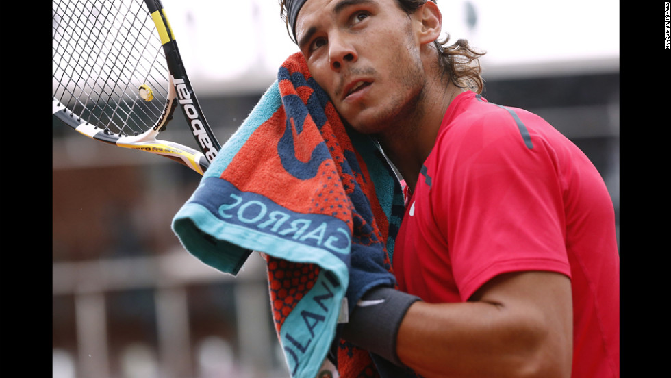 Nadal dries his face during the third set of the match.