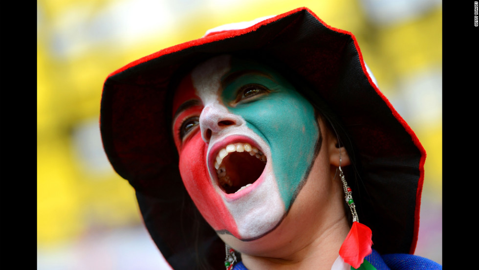 An Italy fan cheers before Sunday's match against Spain.