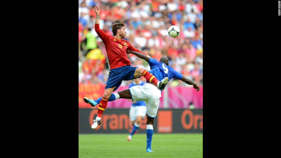 Sergio Ramos of Spain and Mario Balotelli of Italy compete for the ball duing their match in Gdansk, Poland, Sunday, June 10.