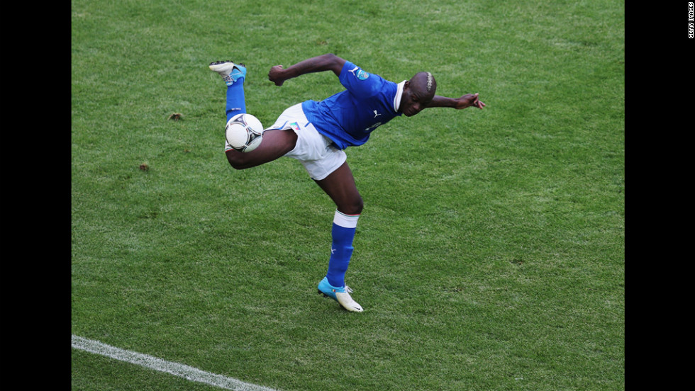 Italy's Mario Balotelli takes control of the ball in Sunday's match against Spain.