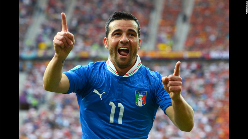 Antonio Di Natale celebrates after scoring Italy's first goal against Spain. Spain was held to a 1-1 draw.