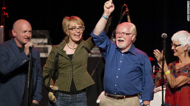Arizona Democratic congressional candidate Ron Barber holds hands with Gabby Giffords during a campaign rally on Saturday.
