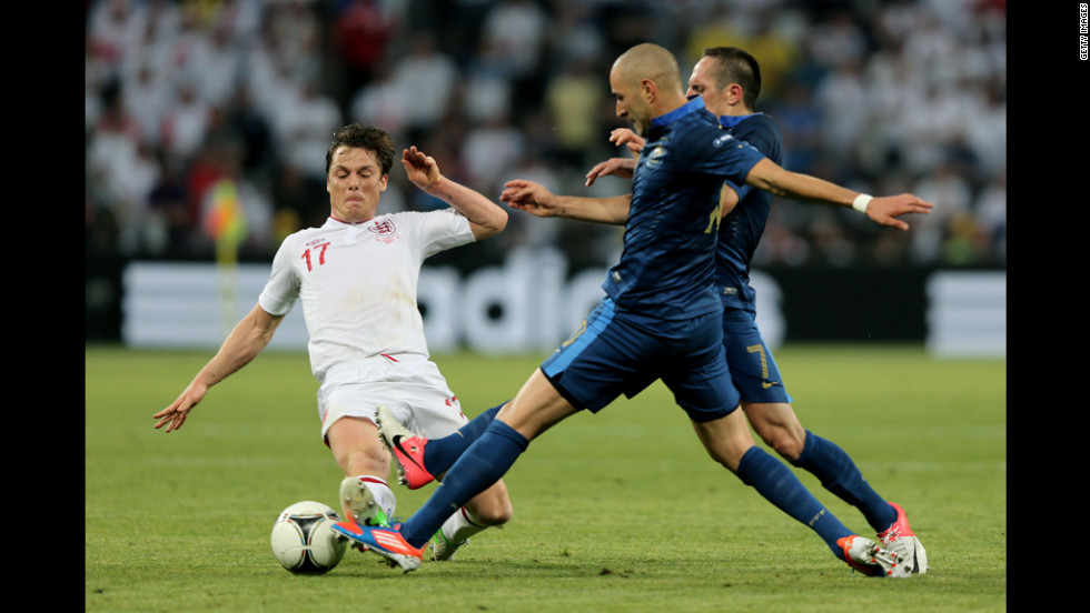 Scott Parker of England fights for possession with Franck Ribery and Karim Benzema of France.
