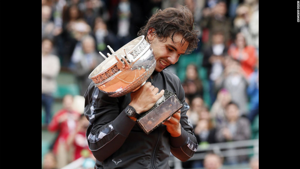Rafael Nadal of Spain celebrates after beating Novak Djokovic of Serbia to win his seventh French Open title in Paris on Monday, June 11.