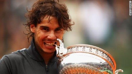 Rafael Nadal of Spain celebrates victory with the Coupe des Mousquetaires trophy in the men's singles final against Novak Djokovic of Serbia during day 16 of the French Open at Roland Garros on June 11, 2012 in Paris, France