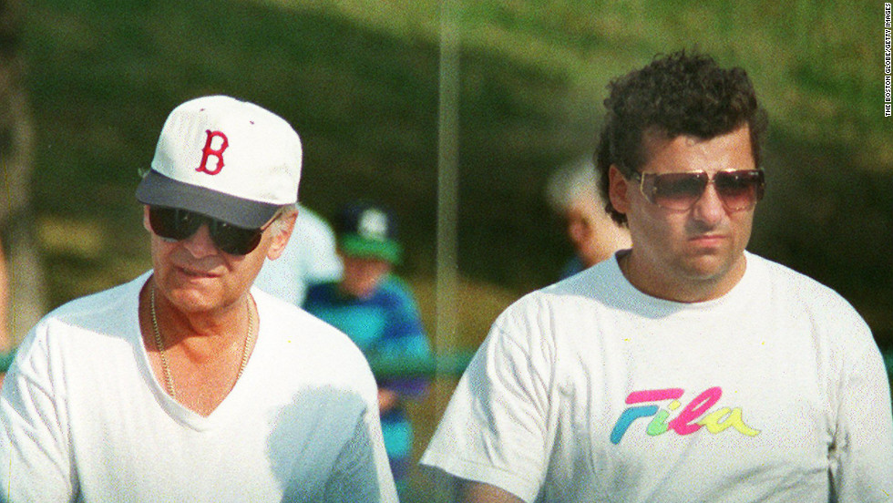 Bulger, left, walks with his onetime friend and confidant Kevin Weeks in Boston in 1994. Weeks later turned on his former boss. In 2000, Weeks led police to the bodies of eight alleged Bulger victims buried around Boston.