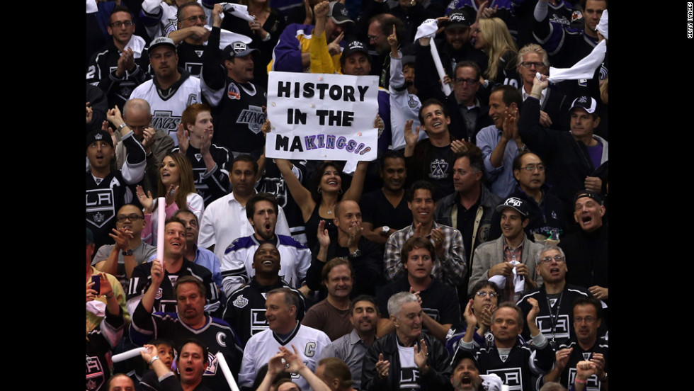 "A Kings fan holds up a sign that reads, ""History in the Makings."" Leading up to game six, the team's 3-0 series lead was cut to 3-2."