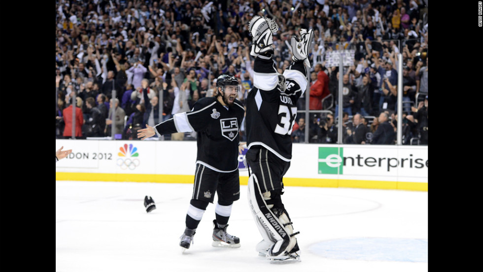 Drew Doughty, left, and Jonathan Quick of the Los Angeles Kings celebrate the team's first Stanley Cup in franchise history.