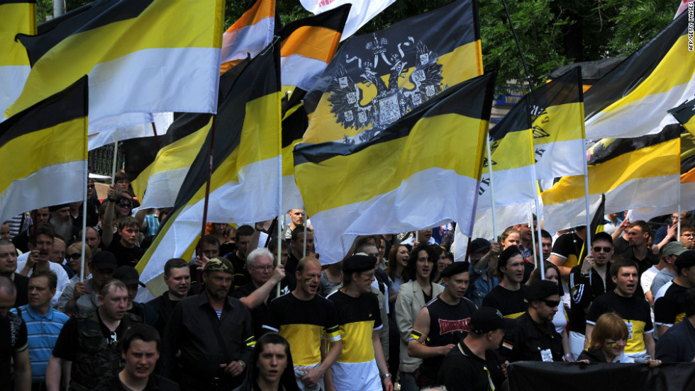 Nationalists carry the black-yellow-white flags of the Russian Empire as they take part in an anti-Putin rally in Moscow.