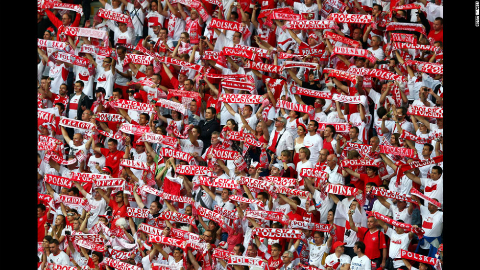 Polish fans cheer during the group A match between Poland and Russia, Tuesday.