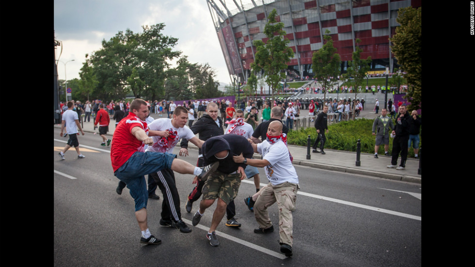 Polish and Russian football fans clash in Warsaw, Poland, on Tuesday ahead of the match between Poland and Russia at the Euro 2012 championships.