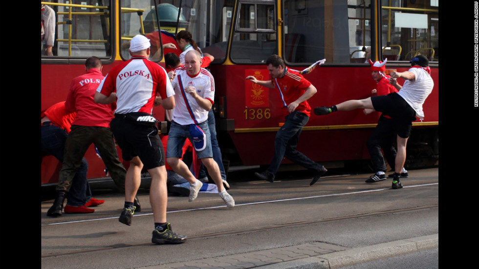 Polish and Russian soccer fans fight before the match between Russia and Poland.