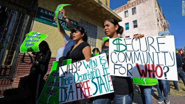 Marchers with the Coalition for Humane Immigrant Rights of Los Angeles protest at an anti-Secure Communities rally.