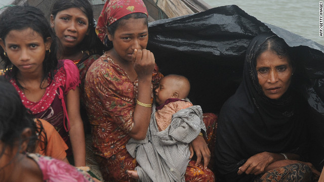 Rohingya Muslims, trying to cross into Bangladesh to escape sectarian violence in Myanmar, June 13, 2012.