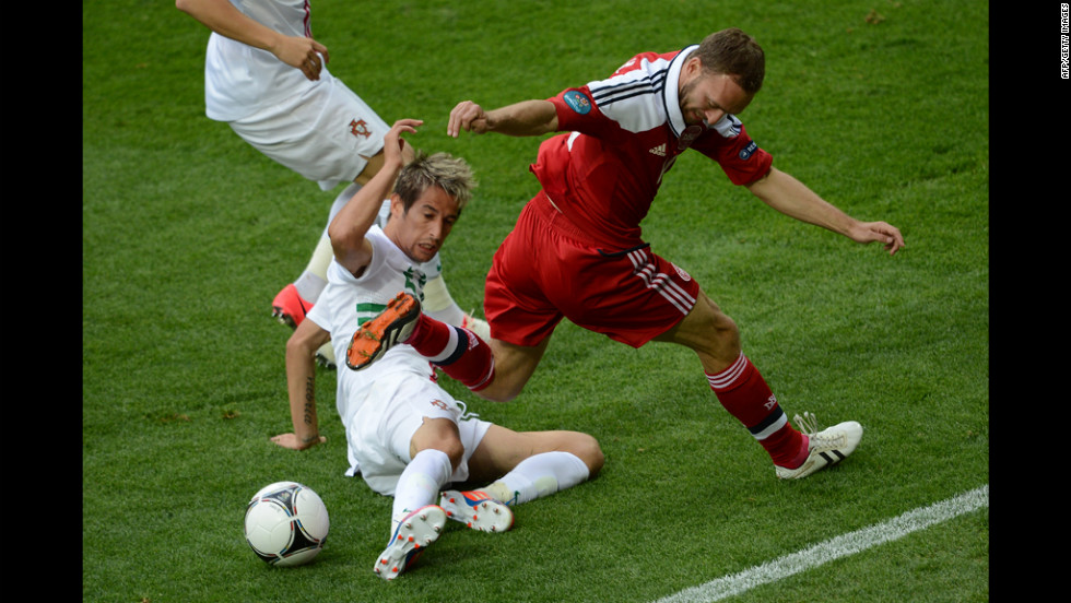 Dennis Rommedahl of Denmark fights for possession with Fabio Coentrao of Portugal.