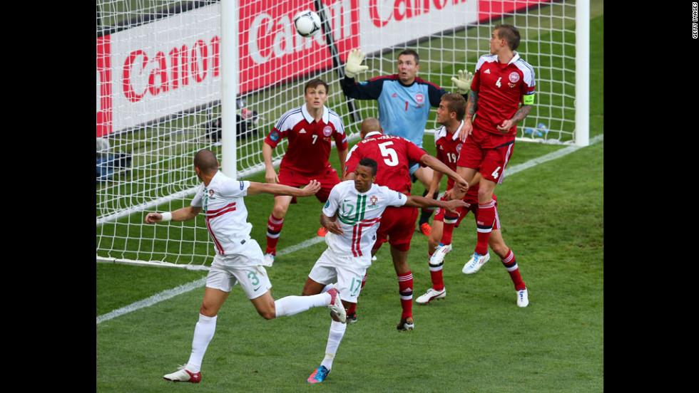 Pepe of Portugal, left, celebrates scores the team's first goal against Denmark.