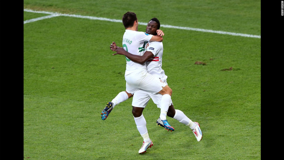Silvestre Varela of Portugal celebrates scoring their third goal against Denmark with Joao Moutinho of Portugal.