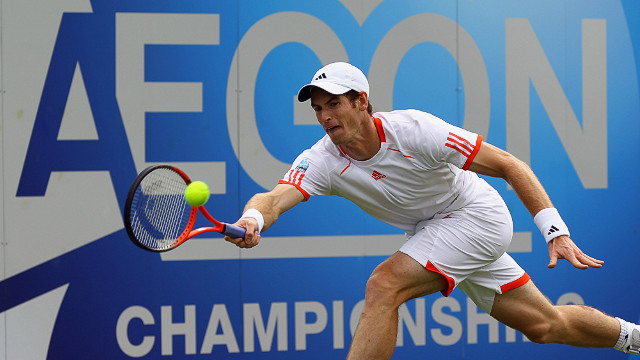 Andy Murray stretches for a forehand during his defeat at the hands of Nicolas Mahut