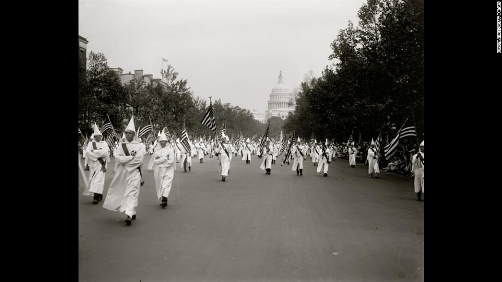 Klan members march in a parade in Washington in 1927.