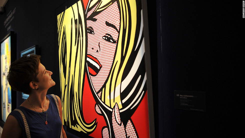 "A woman views ""Girl in Mirror"" by Roy Lichtenstein."