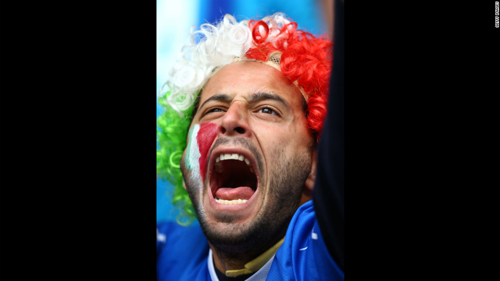 An Italy fan cheers during the team's Group C match against Croatia.