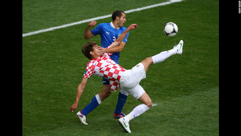 Giorgio Chiellini of Italy and Nikica Jelavic of Croatia compete for the ball.