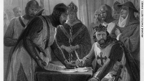 England's King John signs the Magna Carta in 1215.