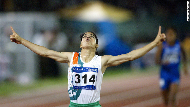 Indian athlete Pinki Pramanik celebrates after winning the women's 400m final at the 10th South Asian Games in Colombo, 25 August 2006.