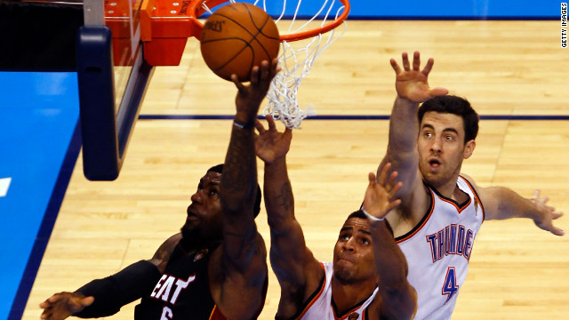 The Miami Heat's LeBron James goes up for a shot against Oklahoma City's Nick Collison and Thabo Sefolosha during Game 2 of the 2012 NBA Finals.