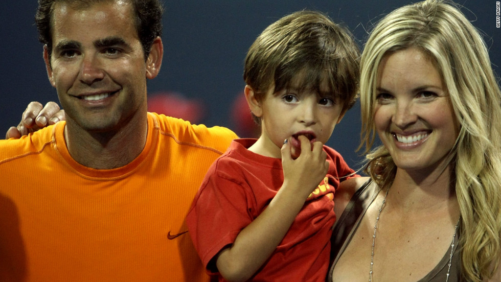 Sampras with actress wife Bridgette, who he married in 2000, and the younger of their two sons, Ryan.