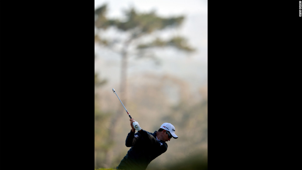 Justin Rose of England hits a shot during the second round of the 112th U.S. Open on Friday.