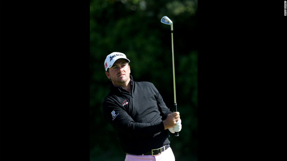 Graeme McDowell of Northern Ireland plays a shot on the 15th hole.