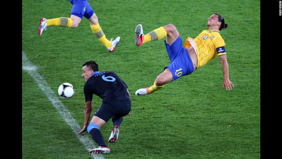 Zlatan Ibrahimovic of Sweden and John Terry of England clash during the match between Sweden and England.