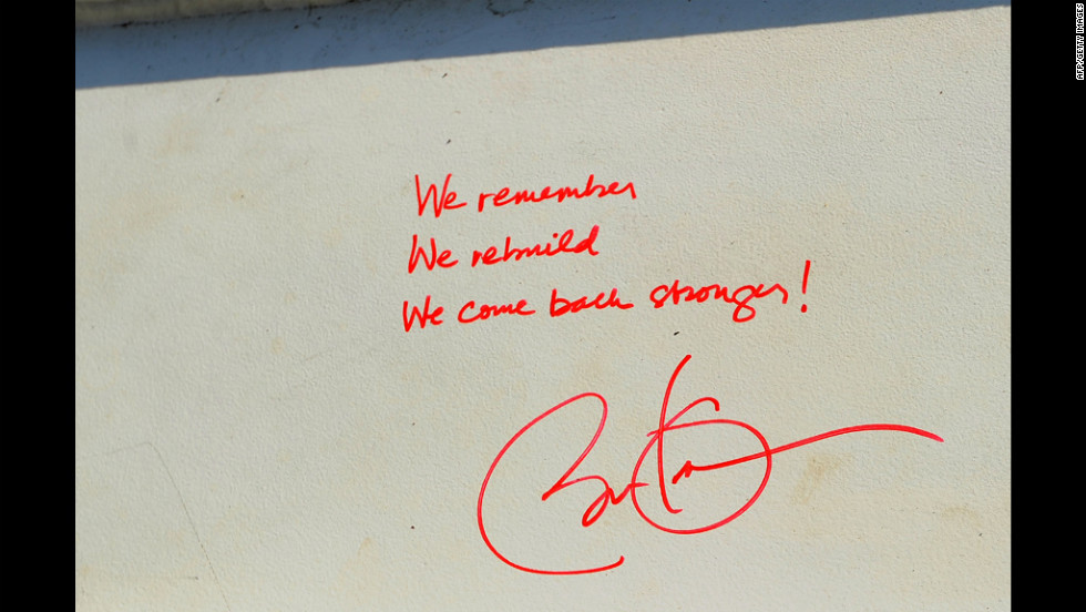 "Obama signed a steel beam for One World Trade Center, writing, ""We remember we rebuild we come back stronger!"""