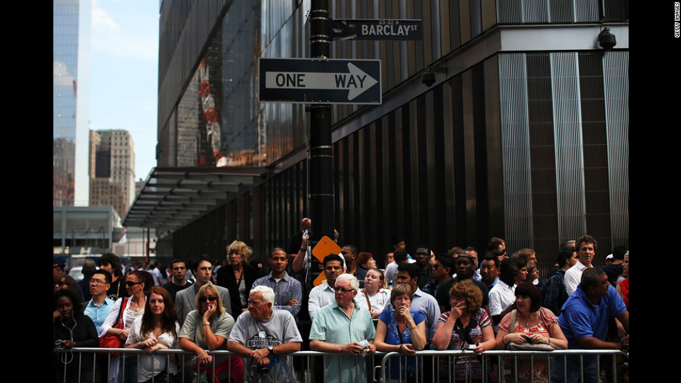 People line the streets for a glimpse of the president and his wife in their motorcade.
