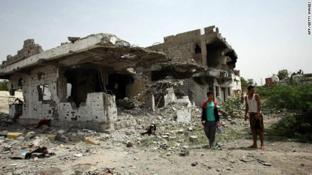 Destruction caused by recent fighting between the army and al Qaeda-linked militants on a road leading to the Yemeni city of Zinjibar on June 14, 2012. (File photo)