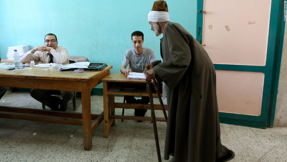 An elderly Egyptian man registers Saturday before voting in the city of Zagazig in an election that pits Ahmed Shafik, the last premier of ousted President Hosni Mubarak, against Muslim Brotherhood candidate Mohammed Morsi.