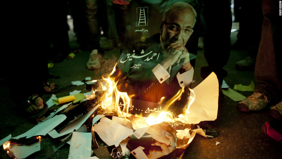 Egyptians burn the likeness of presidential candidate and former Prime Minister Ahmed Shafik in Cairo on Friday, the eve of the nation's presidential election.
