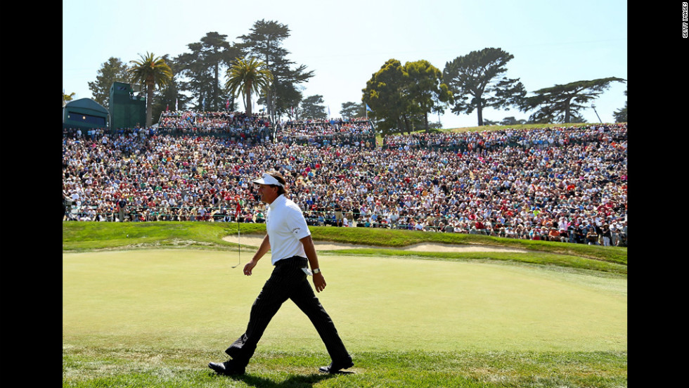 Phil Mickelson walks off the eighth green.