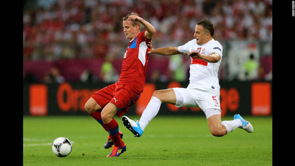 David Limbersky of Czech Republic is tackled by Dariusz Dudka of Poland during the match between Czech Republic and Poland.