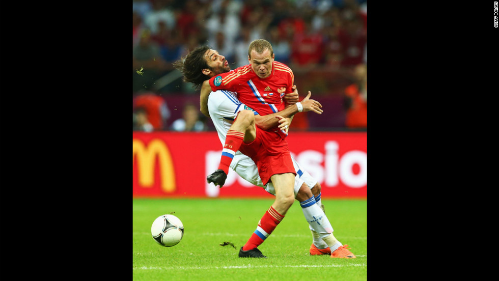 Aleksandr Anyukov of Russia and Georgios Samaras of Greece battle for the ball during the group A match between Greece and Russia.