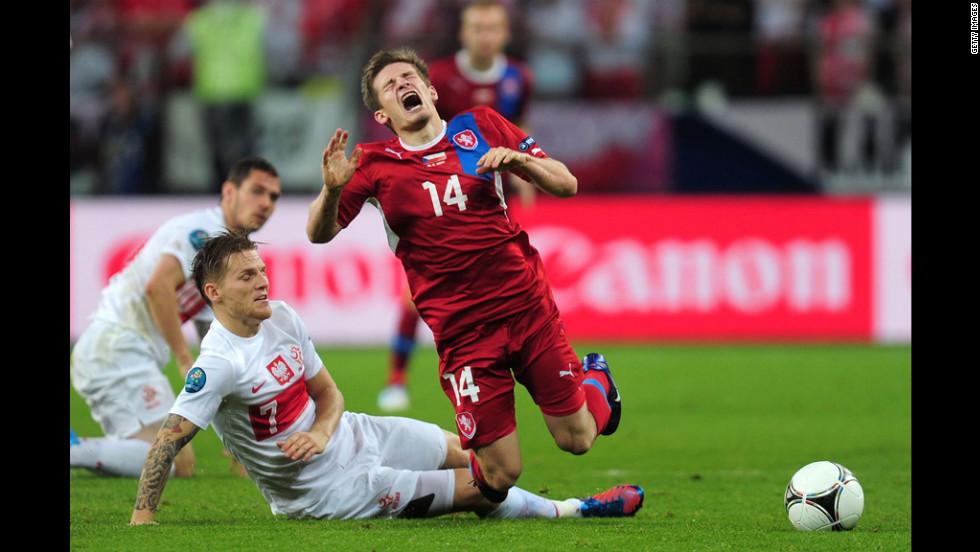 Eugen Polanski of Poland brings down Vaclav Pilar of Czech Republic during the match between Czech Republic and Poland.