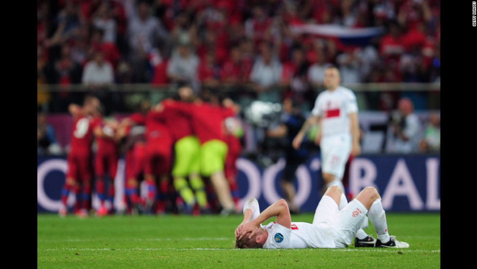 Damien Perquis of Poland lies on the pitch at the final whistle during the match between Czech Republic and Poland.