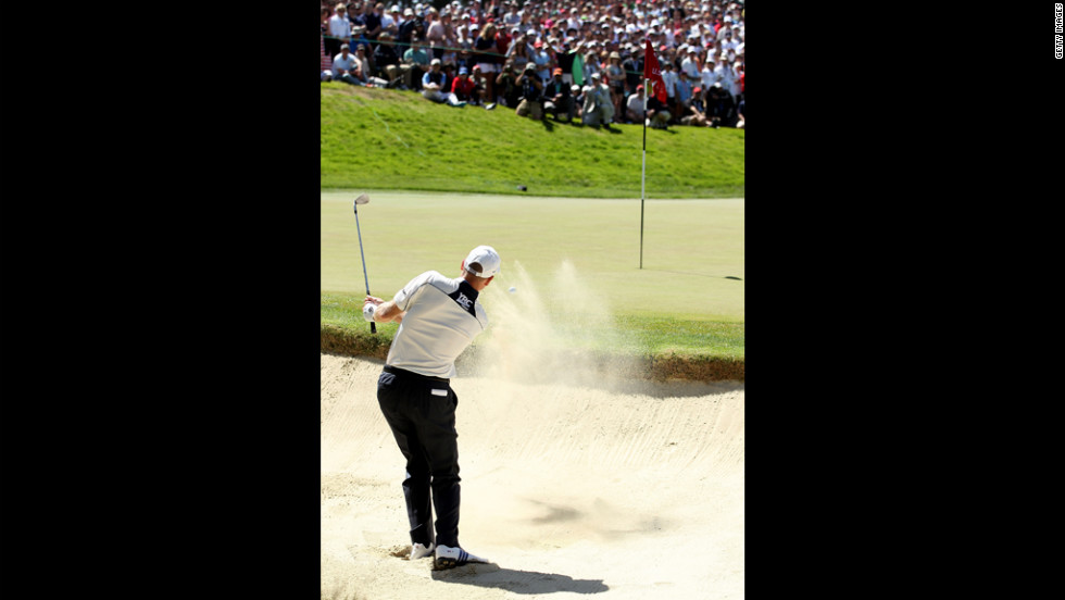 Jim Furyk of the United States plays a bunker shot on the second hole during the third round of the U.S. Open on Saturday, June 16.