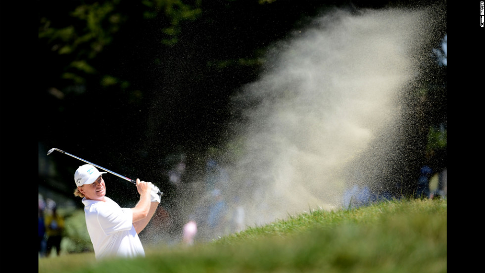 Ernie Els of South Africa plays a bunker shot on the seventh hole during the third round.