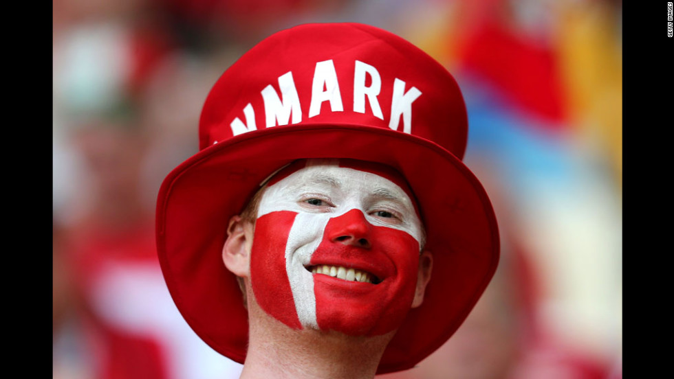 A Danish fan enjoys the atmosphere ahead of the team's match against Germany.