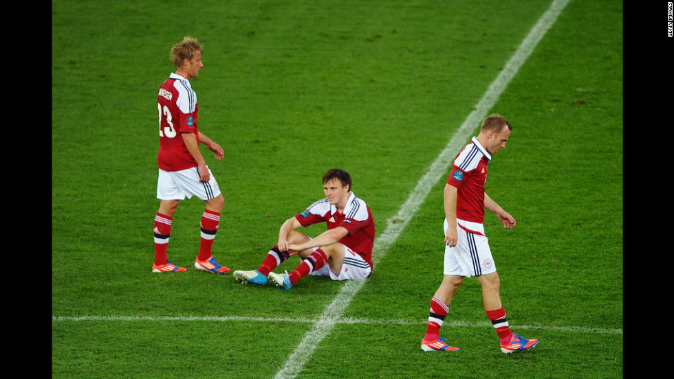 Jores Okore, William Kvist and Lars Jacobsen of Denmark face defeat in the match against Germany on Sunday.