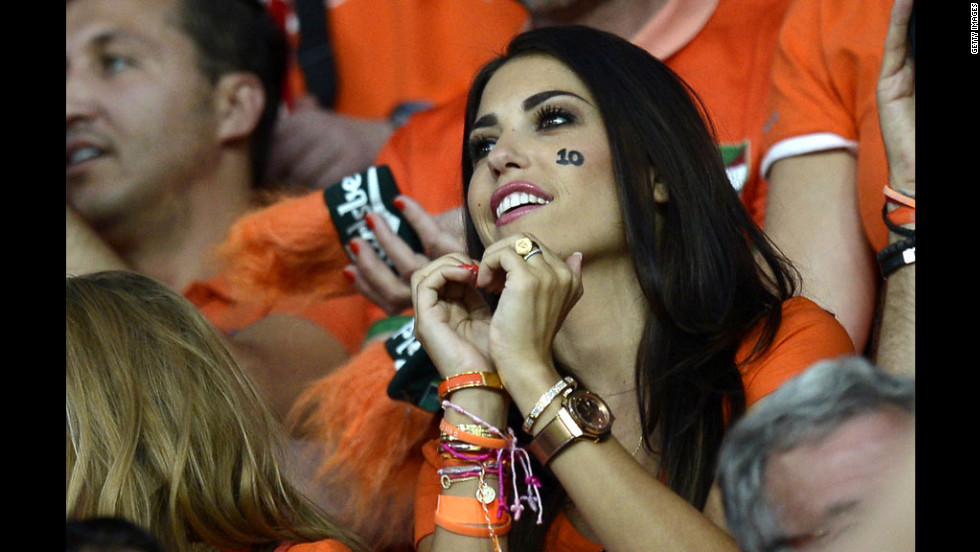 A Dutch fan makes a heart shape with her hands before the start of the team's match against Portugal.
