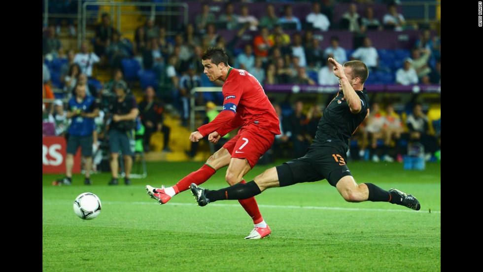 Portugal's Cristiano Ronaldo kicks the ball past a Dutch defender during Sunday's match.